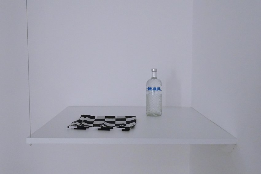 Sean Snyder Duty-Free Molotov Cocktail, 2015-2016 Scarf and vodka on 101 cm x 101 cm x 3 cm PVC support, RAL 9010, supended at height of 120 cm