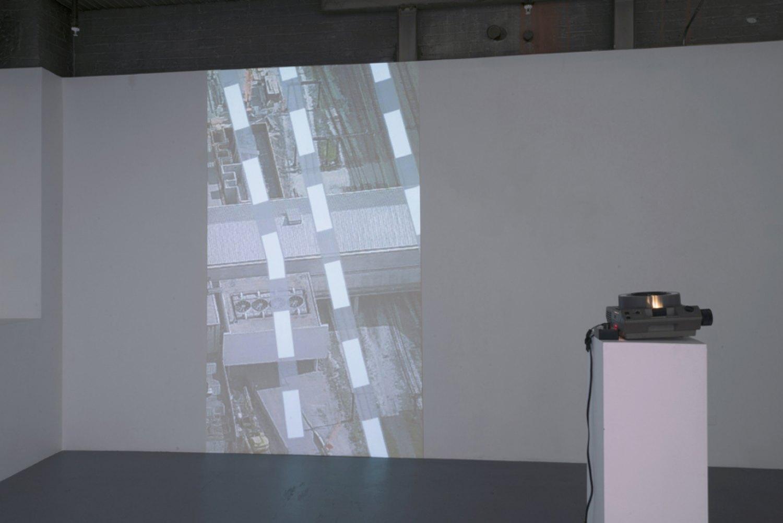 Sean Snyder Vertical Traces, 2015 16:9 format HD video, 1 mintue 20 seconds, color, no audio, projection