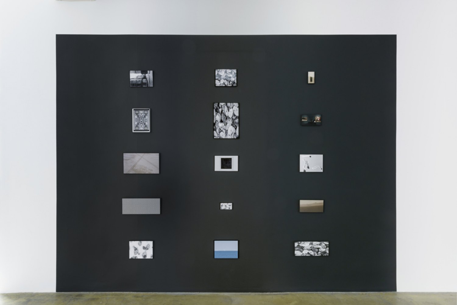Sean Snyder Aspect Ratio (Vanishing Point), 2015-2016 15 color and b/w archival pigment prints on matte paper, 1 cm aluminium frames, installed on wall painted RAL 9017, 3 m high x 4 m wide