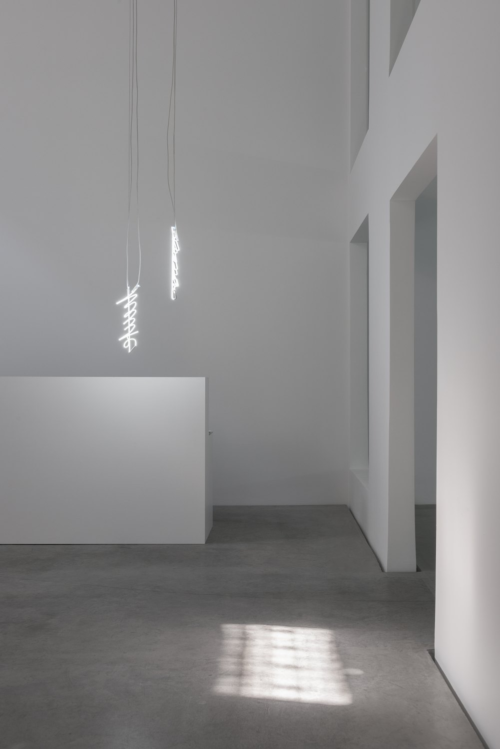 Cerith Wyn Evans 'L=U=M=E=N' After H.D., 2016 (installation view) Neon (white), transformers, 1mm stainless steel cable, wire 47 x 14,5 x 6 cm