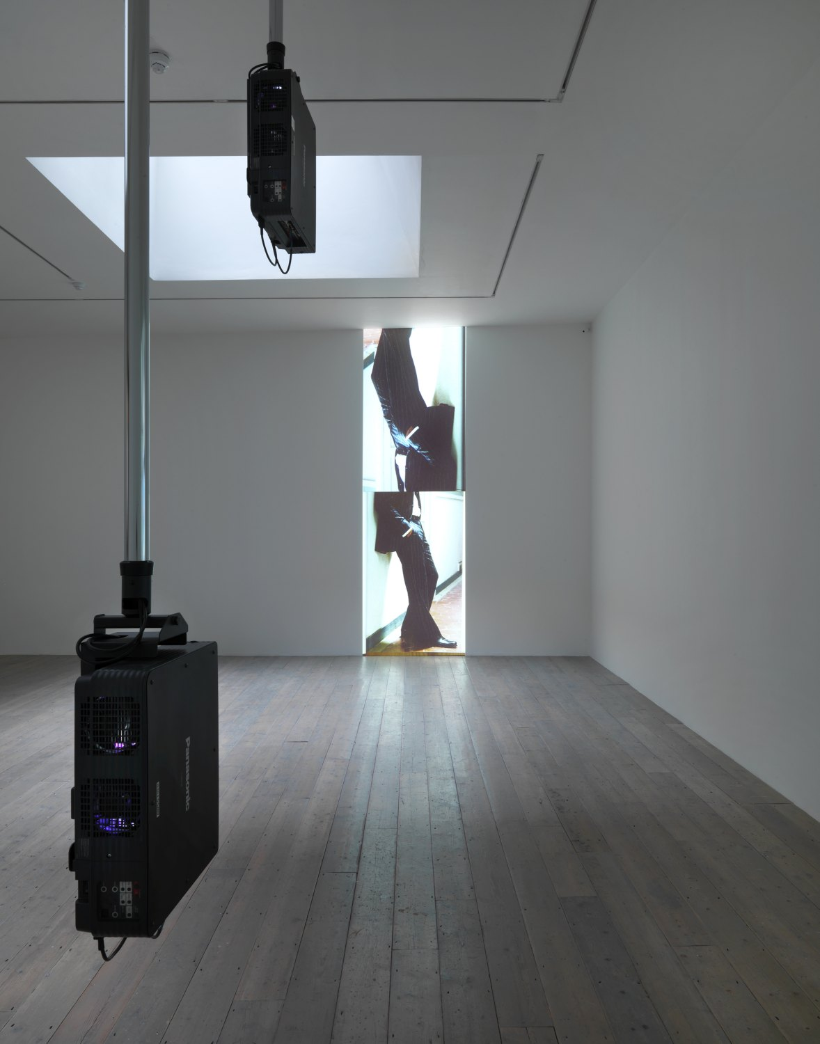 Hilary Lloyd   Trousers, 2010    2 pioneer PT-DW5100U projectors, 2 pioneer DVD-V7300D players, 4 Unicol suspension units, dimensions variable